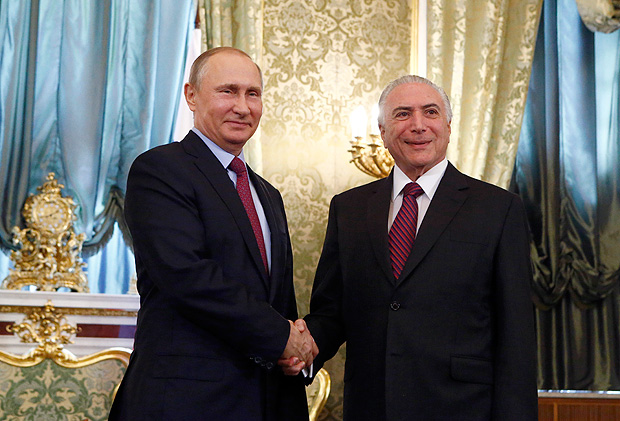 Russian President Vladimir Putin, left, shakes hands with his Brazilian counterpart Michel Temer at the Kremlin, in Moscow, Russia, Wednesday, June 21, 2017. (Sergei Karpukhin/Pool photo via AP) ORG XMIT: MOSB117
