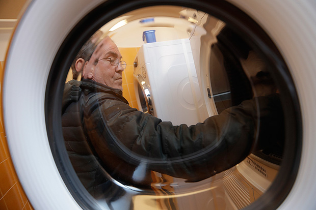 Giuseppe, 53, puts clothes inside a washing machine in a laundry opened in the Sant' Egidio Community Center in Rome, Tuesday, April 11, 2017. Pope Francis has opened a new laundromat for the homeless to wash, dry and iron their clothing and blankets. The laundromat, not far from the Vatican, has six washing machines, six dryers and several ironing boards and irons. (AP Photo/Alessandra Tarantino) ORG XMIT: ALT104