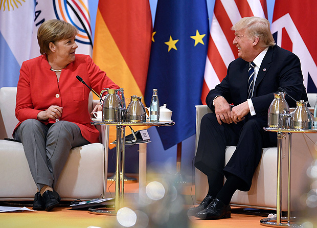 """German chancellor Angela Merkel, left, and U.S. president Donald Trump, attend a """"retreat meeting"""" on the first day of the G-20 summit in Hamburg, northern Germany, on Friday July 7, 2017. Leaders of the world's top economies will gather from July 7 to 8, 2017. (Bernd von Jutrczenka/dpa via AP) ORG XMIT: BHBG121"""
