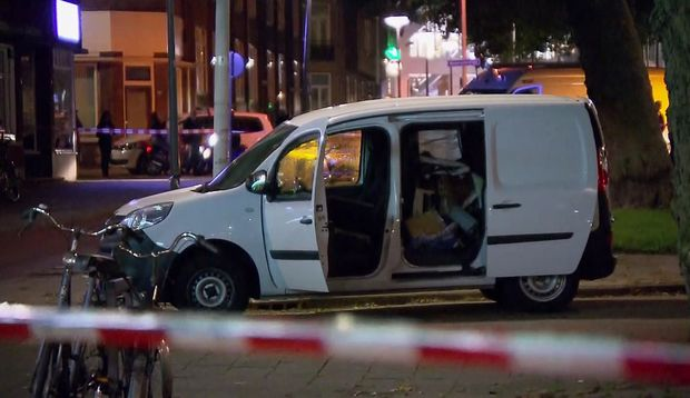 In this image taken from video a van is examined behind a cordoned-off area in Rotterdam, Wednesday Aug. 23, 2017, after a concert by an American rock band was cancelled Wednesday night following a threat, the city's mayor said. Police detained the driver of a van with Spanish license plates carrying a number of gas tanks inside.