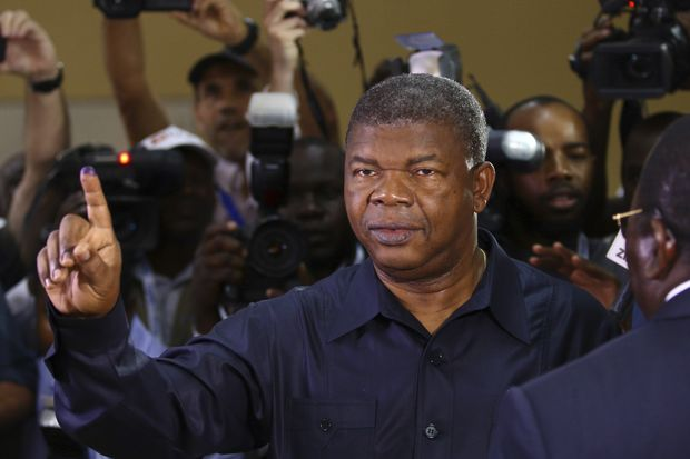 Angola's MPLA main ruling party candidate and defence minister, Joao Lourenco, shows his ink-stained finger after casting his vote in Luanda, Angola, Wednesday, Aug. 23, 2017. Lourenco is the front-runner to succeed President Jose Eduardo dos Santos, who will step down after 38-years in power in an oil-rich country. (AP Photo/Bruno Fonseca) ORG XMIT: XDF101
