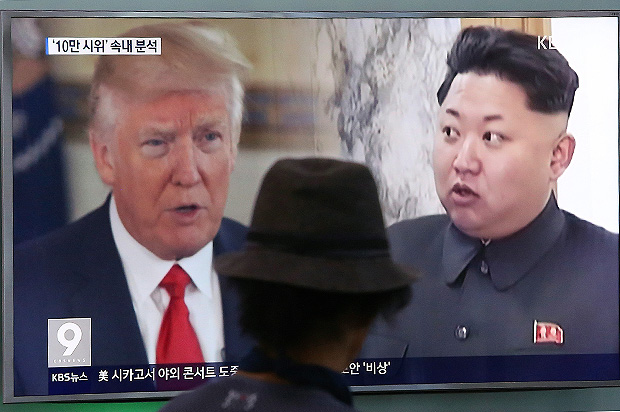 """FILE- In this Aug. 10, 2017, file photo, a man watches a television screen showing U.S. President Donald Trump, left, and North Korean leader Kim Jong Un during a news program at the Seoul Railway Station in Seoul, South Korea. America's annual joint military exercises with South Korea always frustrate North Korea. The war games set to begin Monday, Aug. 21, 2017 may hold more potential to provoke than ever, given Trump's """"fire and fury"""" threats and Pyongyang's as-yet-unpursued plan to launch missiles close to Guam. (AP Photo/Ahn Young-joon, File) ORG XMIT: XSEL105"""