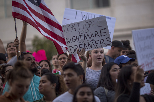 """LOS ANGELES, CA - SEPTEMBER 05: Immigrants and supporters rally and march in opposition to the President Trump order to end DACA, on September 5, 2017 in Los Angeles, United States. The Obama-era Deferred Action for Childhood Arrivals program protects young immigrants who grew up in the U.S. after arriving with their undocumented parents from deportation to a foreign country. The executive order by the president removes protection for about 800,000 current """"dreamers"""", about 200,000 of whom live in Southern California. Congress has the option to replace the policy with legislation before DACA expires on March 5, 2018. David McNew/Getty Images/AFP == FOR NEWSPAPERS, INTERNET, TELCOS & TELEVISION USE ONLY =="""