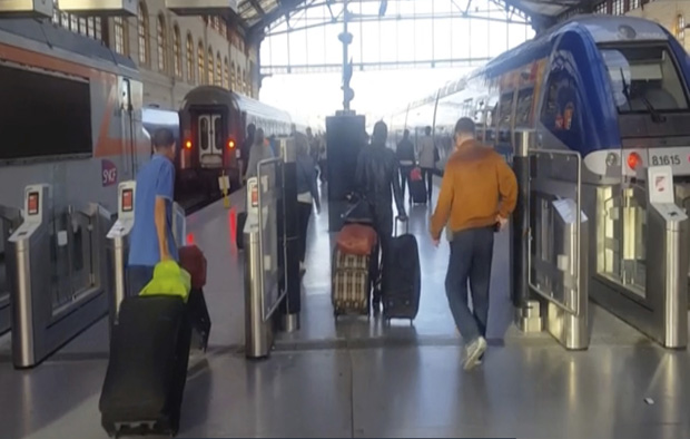 This image taken from video shows passengers inside Marseille-Saint-Charles railway station in Marseille, France on Sunday Sept. 17, 2017. Four young US tourists were attacked with acid Sunday at a train station in the French city of Marseille. (AP Photo) ORG XMIT: LON831