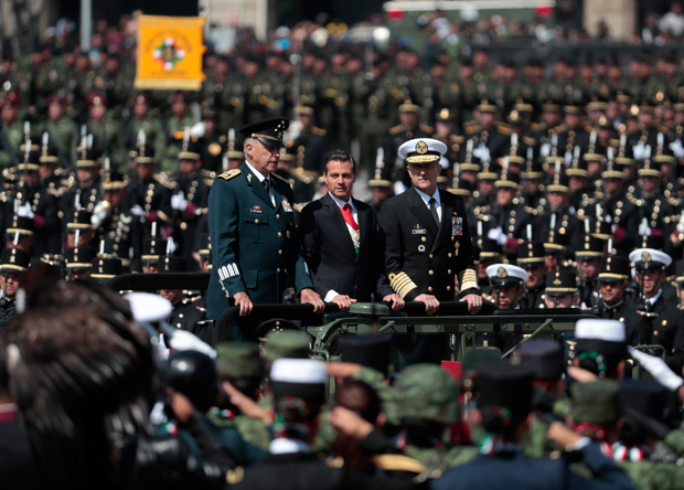 Mexico's President Enrique Pena Nieto reviews troops flanked by Defense Secretary Salvador Cienfuegos Zepeda, left, and Admiral Vidal Francisco Soberon Sanz, at the start of the annual Independence Day military parade in Mexico City's main square, known as the Zocalo, Saturday, Sept. 16, 2017. Mexico is marking the 207th anniversary of its independence from Spain. (AP Photo/Eduardo Verdugo) ORG XMIT: MXEV102