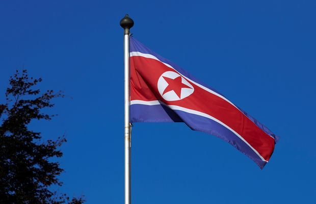 FILE PHOTO - A North Korean flag flies on a mast at the Permanent Mission of North Korea in Geneva October 2, 2014. REUTERS/Denis Balibouse/File Photo ORG XMIT: DBA100
