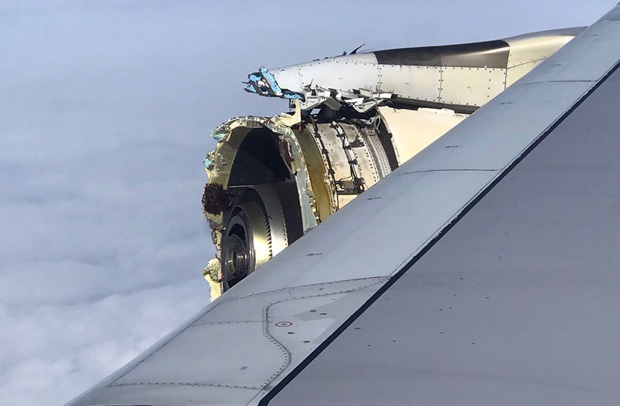 """his photo obtained on the twitter account of @Bdaddy1391 and taken on September 30, 2017 shows the damaged engine of an Air France A380 superjumbo while onboard before it made an emergency landing in Canada. The Air France A380 superjumbo carrying more than 500 people made an emergency landing in Canada after suffering """"serious damage"""" to one of its four engines, with passengers recounting hearing a loud bang followed by violent shaking. / AFP PHOTO / TWITTER / Sarah Eamigh / RESTRICTED TO EDITORIAL USE - MANDATORY CREDIT """"AFP PHOTO / Twitter/ Sarah EAMIGH- NO MARKETING NO ADVERTISING CAMPAIGNS - DISTRIBUTED AS A SERVICE TO CLIENTS"""