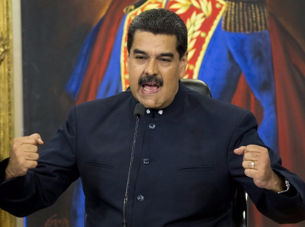 Venezuela's President Nicolas Maduro speaks during a press conference at the Miraflores presidential palace, in Caracas, Venezuela, Tuesday, Oct. 17, 2017. Maduro defended the results of Sunday's gubernatorial elections and said that those who report fraud are lying. (AP Photo/Ariana Cubillos) ORG XMIT: XAC102