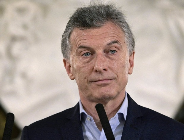 "Argentine President Mauricio Macri looks on during a press conference at Casa Rosada presidential palace in Buenos Aires on October 23, 2017 in the aftermath of national legislative elections. Argentina's President Mauricio Macri's center-right coalition swept crucial midterm elections Sunday and emerged with a strengthened hand to carry through pro-market economic reforms. Macri's Cambiemos, or ""Let's Change,"" won in 13 of Argentina's 23 provinces, as well as in the capital Buenos Aires, according to almost completed counts early Monday. / AFP PHOTO / JUAN MABROMATA ORG XMIT: MAB2187"