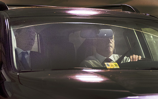 Former Trump Campaign Chairman Paul Manafort, left, leaves his home in Alexandria, Va., Monday, Oct. 30, 2017, in Washington. Manafort, and a former business associate, Rick Gates, have been told to surrender to federal authorities Monday, according to reports and a person familiar with the matter. (AP Photo/Andrew Harnik) ORG XMIT: DCAH102