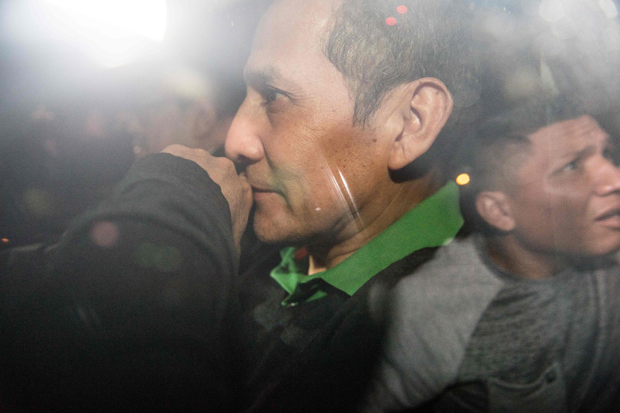 Peruvian former President Ollanta Humalais is being taken to the judge to get his sentence in Lima on July 13, 2017. Humala and his wife Nadine Heredia were sentenced to 18 months of preventive prison on money laundering and conspiracy charges tied to a corruption scandal involving Brazilian construction giant Odebrecht. / AFP PHOTO / ERNESTO BENAVIDES ORG XMIT: 001