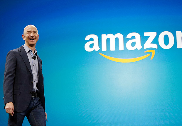 FILE - In this June 16, 2014 file photo, Amazon CEO Jeff Bezos walks on stage for the launch of the new Amazon Fire Phone, in Seattle. Amazon.com reports quarterly financial results on Thursday, Oct. 23, 2014. (AP Photo/Ted S. Warren, File) ORG XMIT: NYBZ197