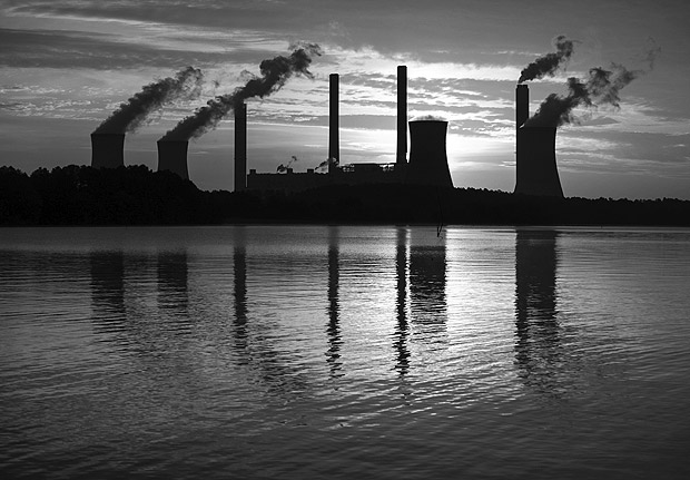 FILE - In this June 3, 2017, file photo, the coal-fired Plant Scherer, one of the nation's top carbon dioxide emitters, stands in the distance in Juliette, Ga. The Trump administration intends to roll back the centerpiece of former President Barack Obama?s efforts to slow global warming, seeking to ease restrictions on greenhouse gas emissions from coal-fired power plants. (AP Photo/Branden Camp, File) ORG XMIT: WX138