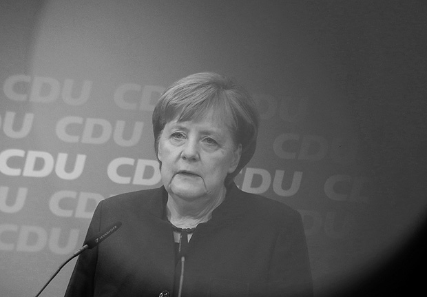 German Chancellor Angela Merkel speaks behind the red light of a TV camera during a press conference after a board meeting of her Christian Democratic Party CDU in Berlin, Germany, Monday, Nov. 27, 2017. (Michael Kappeler/dpa via AP) ORG XMIT: FOS106