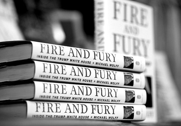 """CORTE MADERA, CA - JANUARY 05: Copies of the book """"Fire and Fury"""" by author Michael Wolff are displayed on a shelf at Book Passage on January 5, 2018 in Corte Madera, California. A controversial new book about the inner workings of the Trump administration hit bookstore shelves nearly a week earlier than anticipated after lawyers for Donald Trump issued a cease and desist letter to publisher Henry Holt & Co. Justin Sullivan/Getty Images/AFP == FOR NEWSPAPERS, INTERNET, TELCOS & TELEVISION USE ONLY =="""