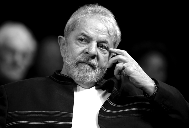 Former Brazilian president Luiz Inacio Lula da Silva reacts during a meeting with intellectuals in Rio