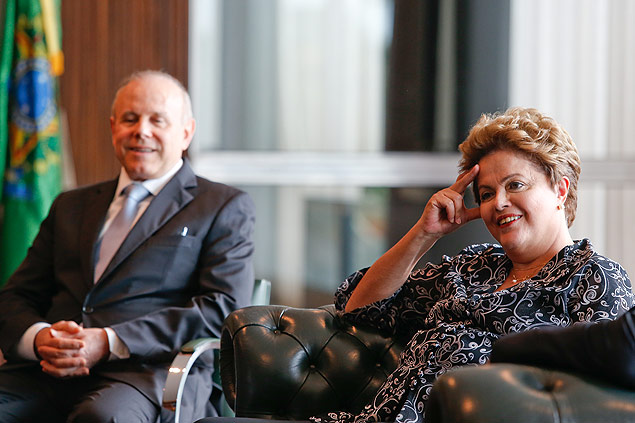 Finance Minister Guido Mantega (left) might be substituted if Ms Rousseff is reelected