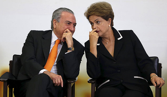 Brazil's President Dilma Rousseff (R) listens to Vice President Michel Temer during a ceremony for the launch of the National Plan for Export at the Planalto Palace in Brasilia, Brazil, June 24, 2015. REUTERS/Bruno Domingos ORG XMIT: BSB102