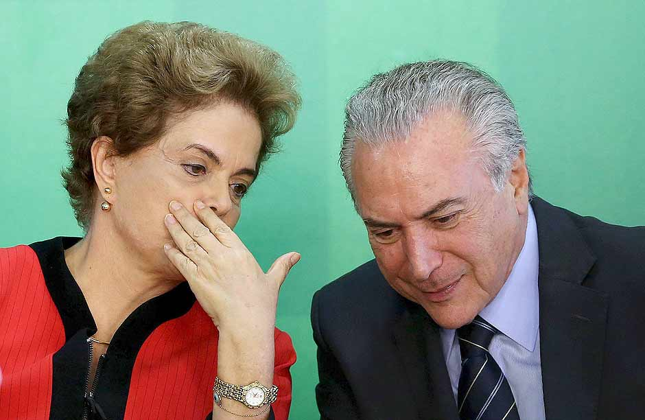 Brazil's President Dilma Rousseff (L) talks to Vice President Michel Temer at the Planalto Palace in Brasilia, Brazil, in this March 2, 2016 file photo. Brazil's President Dilma Rousseff scrambled on March 30, 2016, to hold together her crumbling ruling coalition by negotiating key government posts with remaining allies, aides said, as key partners discussed abandoning her amid impeachment proceedings. REUTERS/Adriano Machado/Files ORG XMIT: TOR611