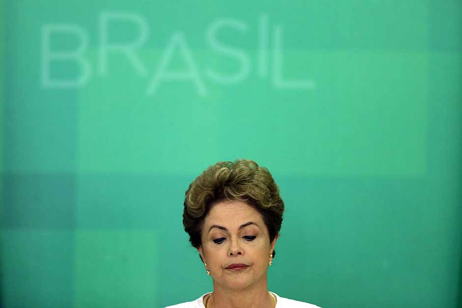 Brazil's President Dilma Rousseff looks down during a press conference after impeachment proceedings were opened against her by the President of Chamber of Deputies Eduardo Cunha, at the Planalto Presidential Palace in Brasilia, Brazil, Wednesday, Dec. 2, 2015. The speaker of the nation's lower house says he's opening the impeachment process based on accusations that Rousseff's government broke fiscal responsibility laws this year. (AP Photo/Eraldo Peres) ORG XMIT: ERA103