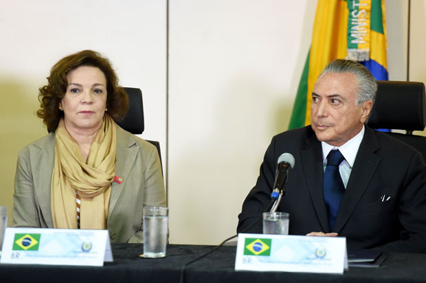 Brazil's acting President Michel Temer (R) and National Secretary of Policy for Women Fatima Pelaes are pictured during a meeting with the secretaries of security of Brazilian states, in Brasilia, on May 31, 2016. Temer proposed a 'joint effort' to 'ban' violence against women following two gang rapes of teenage girls including one in Rio de Janeiro supposedly involving 30 men that was filmed and posted online and that has shocked Brazil. / AFP PHOTO / EVARISTO SA ORG XMIT: ESA1169