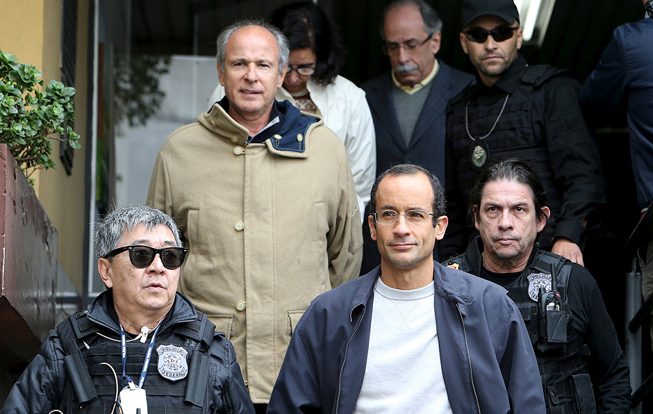 Marcelo Odebrecht (bottom, R), the head of Latin America's largest engineering and construction company Odebrecht SA, and Otavio Marques Azevedo (2nd L), CEO of Brazil's second largest builder Andrade Gutierrez, are escorted by federal police officer Newton Ishii (L) as they leave the Institute of Forensic Science in Curitiba, Brazil, June 20, 2015. REUTERS/Rodolfo Burher/File photo ORG XMIT: BRA101