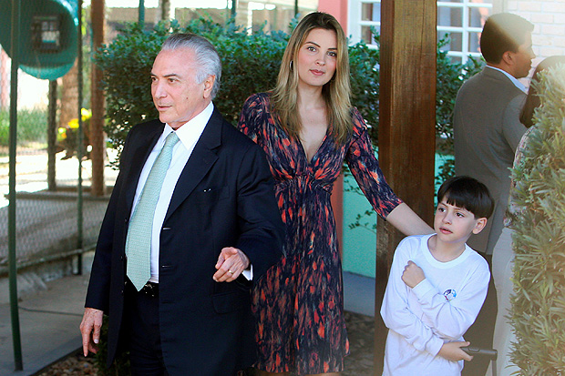 Brazil's interim President Michel Temer and his wife, Marcela Temer, accompany their son Michel during his first day back to school, in Brasilia, Brazil July 26, 2016. REUTERS/Adriano Machado ORG XMIT: BSB5