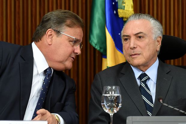 "(FILES) This file photo taken on June 15, 2016 shows then Brazilian acting President Michel Temer (R) and the General Secretary of the Brazilian Presidency Geddel Vieira Lima speaking during a meeting with party leaders of the National Congress at Planalto Palace in Brasilia. Vieira Lima resigned on November 25, 2016 amid a political crisis in Brazil. Brazilian President Michel Temer denied Thursday having ""prompting"" any of his ministers to take a decision that would ""hurt his convictions"", after former Brazilian Culture Minister Marcelo Calero declared having been put pressure on a case about real estate interests. / AFP PHOTO / EVARISTO SA ORG XMIT: ESA1252"