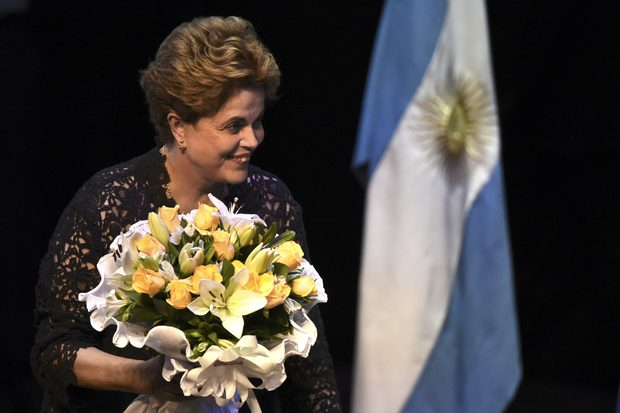Former Brazilian President Dilma Rousseff acknowledges the audience during a meeting at the UMET (Universidad Metropolitana para la Educacion y el Trabajo) in Buenos Aires, on December 22, 2016 where she gave a lecture on democracy and social justice. / AFP PHOTO / EITAN ABRAMOVICH ORG XMIT: EAS831