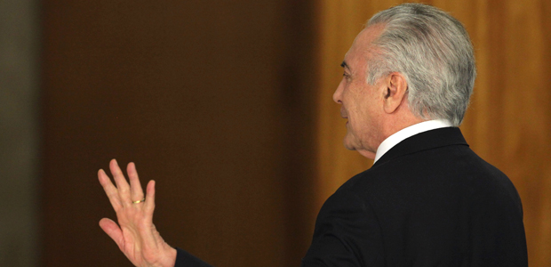 Brazil's President Michel Temer waves goodbye following his statement at Planalto presidential palace in Brasilia, Brazil, Wednesday, Aug. 2, 2017, after surviving a key congressional vote that could have suspended him over a bribery charge. The bribery allegation, which stunned even Brazilians inured to graft cases, was the latest in a bevy of scandals that has rocked the administration and created deep uncertainty and angst in Latin America's largest nation. (AP Photo/Eraldo Peres) ORG XMIT: ERA138