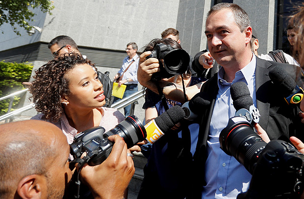 Brazil's billionaire businessman Joesley Batista talks with journalists as he leaves the Federal Police headquarters after giving testimony, in Sao Paulo