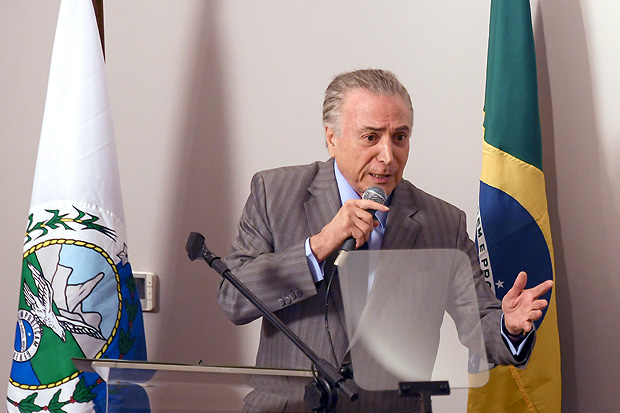 Brazil's President Michel Temer delivers a speech during the opening ceremony of the Paulo Niemeyer Brain's Institute (Centro de Radiocirurgia do Instituto Estadual do Cerebro Paulo Niemeyer), in Rio de Janeiro, Brazil, on September 15, 2017. Brazil's chief prosecutor on Thursday charged President Michel Temer with obstruction of justice and leading a criminal group in the biggest climax yet to the country's ever-growing corruption scandal. / AFP PHOTO / Apu Gomes