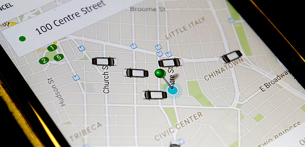 In this Wednesday, March 18, 2015, photo the Uber app displays on a smart phone cars available for a pick up in downtown Manhattan. New York City's storied yellow cabs are taking a back seat to Uber now that the ride-sharing app has more vehicles registered in the city than the total number of taxis. (AP Photo/Mary Altaffer) ORG XMIT: NYMA103