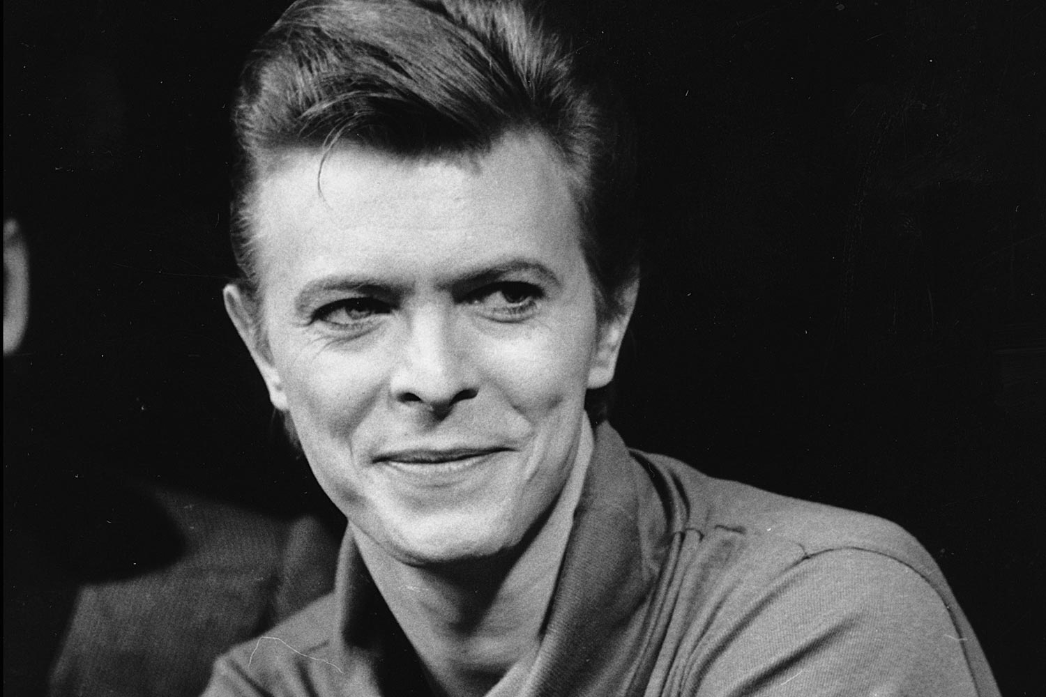 """FILE i In this Sept. 17, 1980, file photo, David Bowie listens during a news conference after a rehearsal at the Booth Theater in New York. Bowie was appearing in the Broadway production of """"The Elephant Man."""" Bowie, the innovative and iconic singer whose illustrious career lasted five decades, died Monday, Jan. 11, 2016, after battling cancer for 18 months. He was 69. (AP Photo/Marty Lederhandler, FIle) ORG XMIT: NYET911"""