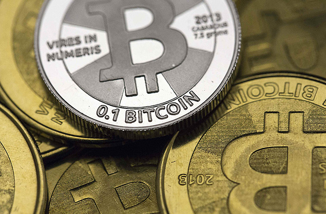 Some of Bitcoin enthusiast Mike Caldwell's coins are pictured at his office in this file photo illustration in Sandy, Utah January 31, 2014. Mt. Gox, once the world's largest bitcoin exchange, filed for U.S. Bankruptcy in Dallas late Sunday, a move that will temporarily put U.S. legal action on hold against the Japanese company. REUTERS/Jim Urquhart/Files REUTERS/Jim Urquhart (UNITED STATES - Tags: BUSINESS) ORG XMIT: TOR909