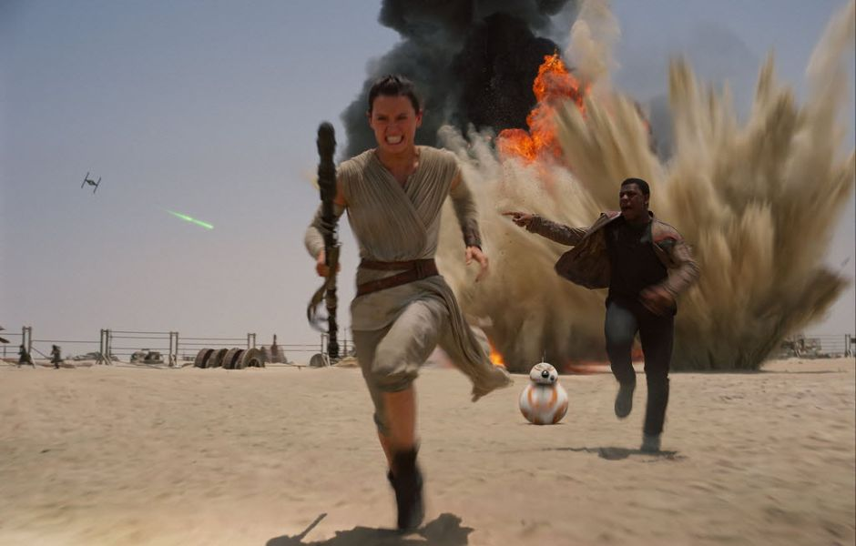 """FILE- This undated file photo provided by Disney shows Daisey Ridley as Rey, left, and John Boyega as Finn, in a scene from the film, """"Star Wars: The Force Awakens."""" Hasbro said it is changing its Star Wars Monopoly set after an 8-year-old girl became upset that Rey, the movie's female heroine, was not included as a figure along with Darth Vader and Kylo Ren. (Disney/Lucasfilm via AP, File) MANDATORY CREDIT ORG XMIT: BX302"""