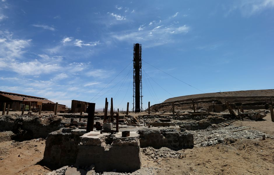 (131018) -- SANTIAGO, Oct. 18, 2013 (Xinhua) -- Photo taken on Oct. 13, 2013 shows remains in the Humberstone saltpeter works. Humberstone and Santa Laura saltpeter works are located some 50 km east of the city of Iquique, northern Chile. Both works were founded in 1872, and abandoned in late 1950s after the blossom of saltpeter extraction. In 2005 they were declared a World Heritage Site by UNESCO. Humberstone and Santa Laura works contain over 200 former saltpeter works where workers lived in company towns and forged a distinctive communal culture. Situated in desert, thousands of miners lived and worked in this hostile environment, producing the fertilizer sodium nitrate that was to transform agricultural lands in the world, and produce great wealth for Chile. Because of the vulnerability of the structures and because of the impact of a recent earthquake, the site was also placed on the List of World Heritage in Danger. (Xinhua/Zhang Chuanqi) (zw)
