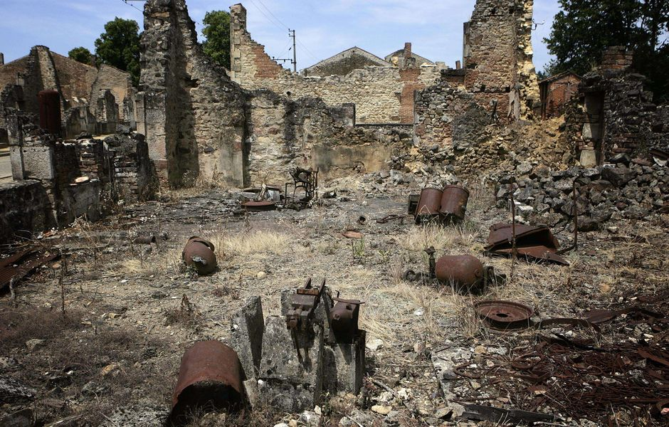 FILES - View taken on June 10, 2006 of the J B Baulieu blacksmith ruins in Oradour-sur-Glane village, central France, in which 642 citizens including 500 women and children were killed locked up in a church intentionally set on fire by a SS division 10 June 1944. A German court on December 9, 2014 threw out the case against an 89-year-old former soldier over the Nazis' worst atrocity on French soil, the 1944 massacre in the village of Oradour-sur-Glane. AFP PHOTO OLIVIER LABAN-MATTEI ORG XMIT: OLM52