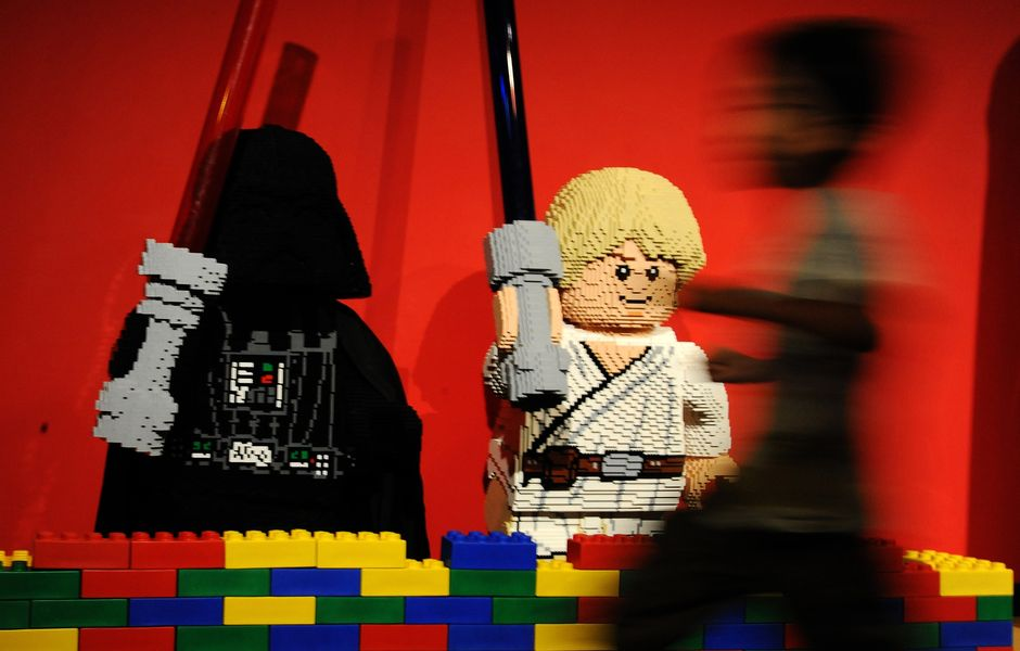 "A boy runs in front of Lego-made Darth Vader (L) and Luke Skywalker (C), characters in the US movie ""Star Wars"" at LegoLand in Tokyo on September 15, 2013. The Lego Star Wars event started from September 14 to attract Star Wars fans. AFP PHOTO / RIE ISHII ORG XMIT: KIT137"