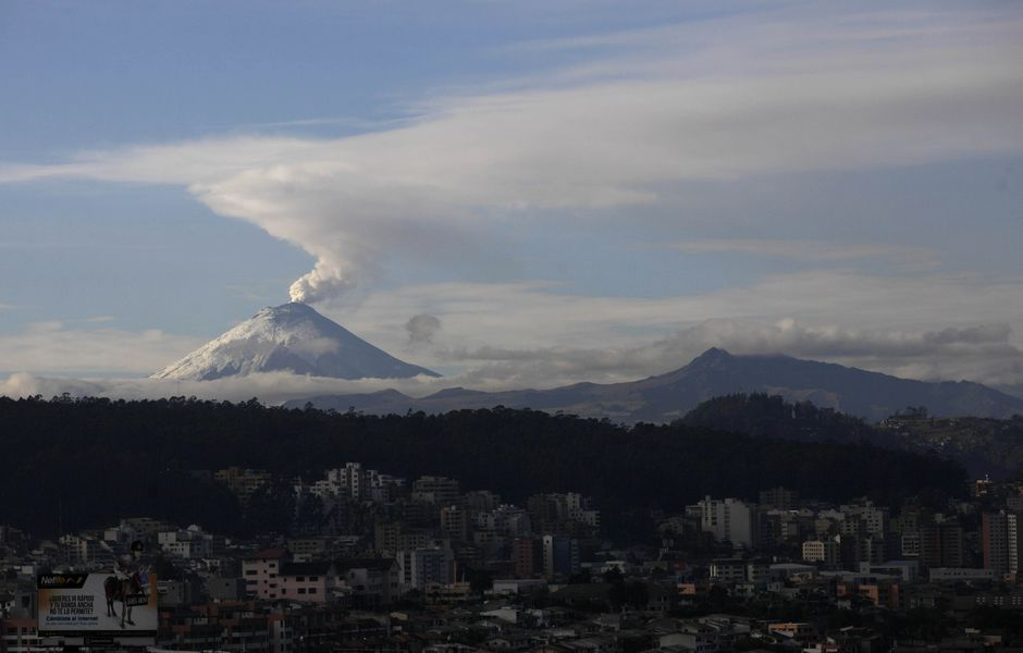 The Cotopaxi volcano spews ash and vapor, seen from Quito, Ecuador, Monday, Oct. 19, 2015. Cotopaxi began showing renewed activity in April and its last major eruption was in 1877. (AP Photo/Dolores Ochoa) ORG XMIT: DOR101