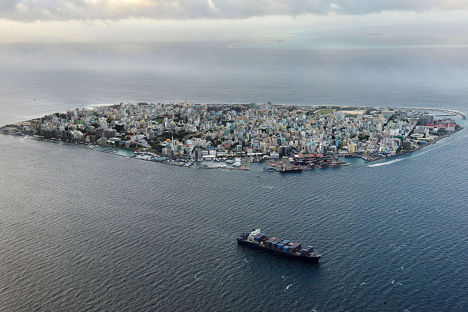 (FILES) This photograph taken on September 9, 2013, shows an aerial view of the island of Male, the capital of the Maldives. Maldives President Abdulla Yameen declared a state of emergency on November 3, 2015, giving sweeping powers to security forces to arrest suspects ahead of a major anti-government protest rally, his spokesman said. The move came two days ahead of a planned protest by the main opposition Maldivian Democratic Party (MDP), whose leader Mohamed Nasheed is in jail after a widely criticised conviction under anti-terror laws. AFP PHOTO/ Roberto SCHMIDT/FILES ORG XMIT: RAS002
