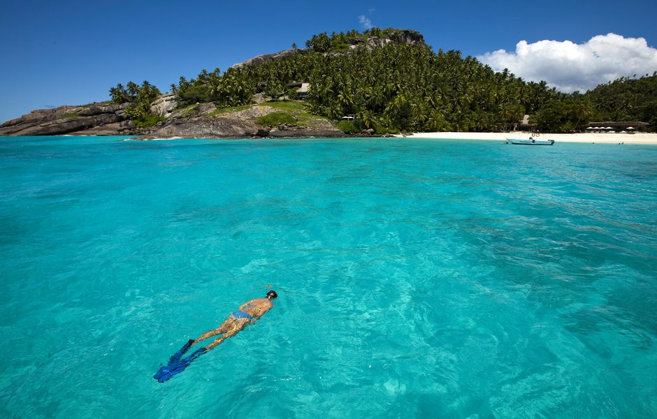 Turista mergulha no norte das ilhas Seychelles, no Oceano �ndico, que recebeu 550 brasileiros em 2013. *** ORG XMIT: LON815 Undated image released by Wilderness Safaris on Tuesday May 10 2011 of a swimmer off North Island resort in the Seychelles, an archipelago in the Indian Ocean. Germany-based real estate mogul Farhad Vladi told a German daily he had rented the island to the Windsors, claiming that Britain's Prince William and his wife, Kate, Duchess of Cambridge, would be taking their delayed honeymoon there. Srdjana Janosevic, the press secretary for the Seychelles' president, had no confirmation Tuesday that the royal couple had arrived or planned to vacation, but noted they have visited the Seychelles before. (AP Photo/ Anthony Grote, Wilderness Safaris) EDITORIAL USE ONLY. NO SALES