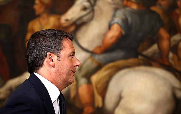 Italian Prime Minister Matteo Renzi leaves at the end of media conference after a referendum on constitutional reform at Chigi palace in Rome, Italy, December 5, 2016.