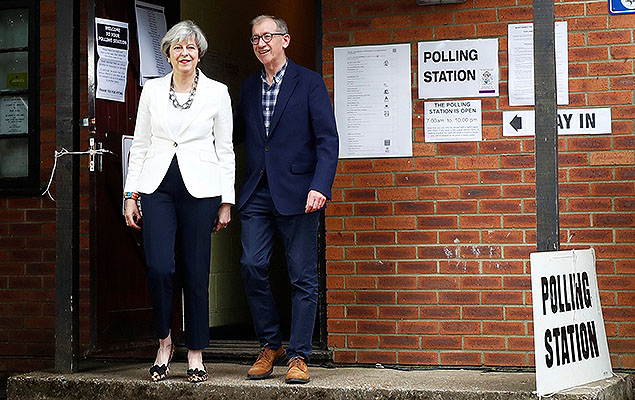 Britain's Primer Minister Theresa May and her husband Philip leave a polling station in Sonning, Britain, June 8, 2017.