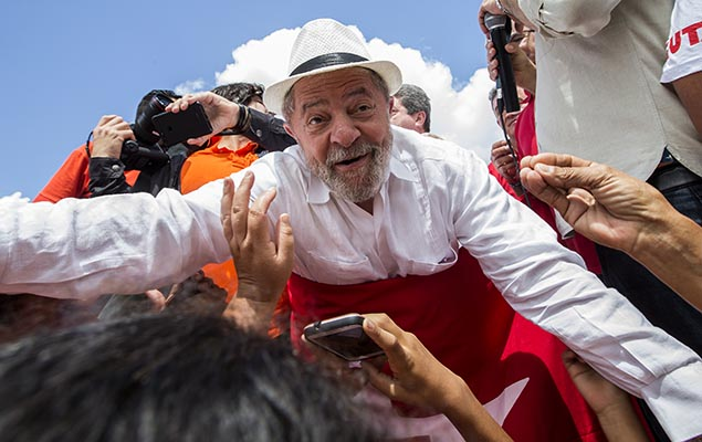 Ex-president Lula da Silva cheers supporters during a rally in Pernambuco state
