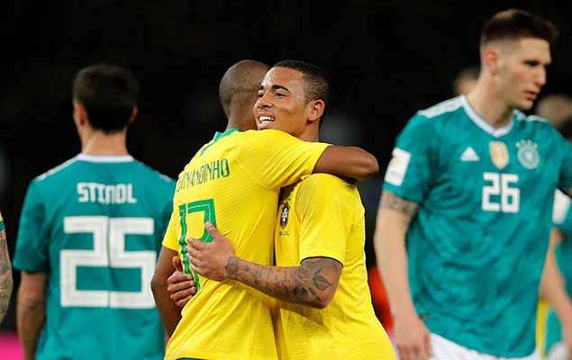 Gabriel Jesus (C) celebrates after scoring against Germany during their international friendly on Tuesday