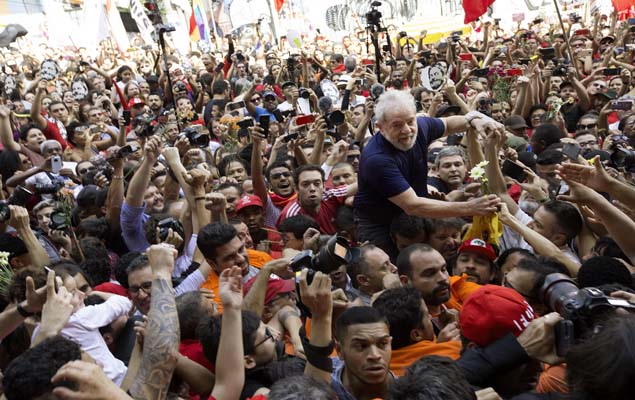 Former Brazilian president Luiz Inácio Lula da Silva waves to supporters on April 7 at the metalworkers' union headquarters in Sao Paulo, Brazil, where he had avoided prison for two days