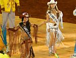 Eloisa Moreira (in white), Queen of the Festa do Peo [Cowboy Festival], parades with samba school at the festival