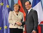 O presidente francs, Franois Hollande, cumprimenta a chanceler alem, Angela Merkel aps conferncia em Berlim Leia mais