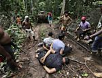 Ka'apor Indian warriors tie up loggers during a jungle expedition to search for and expel them from the Alto Turiacu Indian territory, near the Centro do Guilherme municipality in the northeast of Maranhao state in the Amazon basin